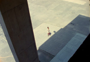 Chandigarh Bolex 16 mm video still Le Corbusier Jeanneret concrete building girl