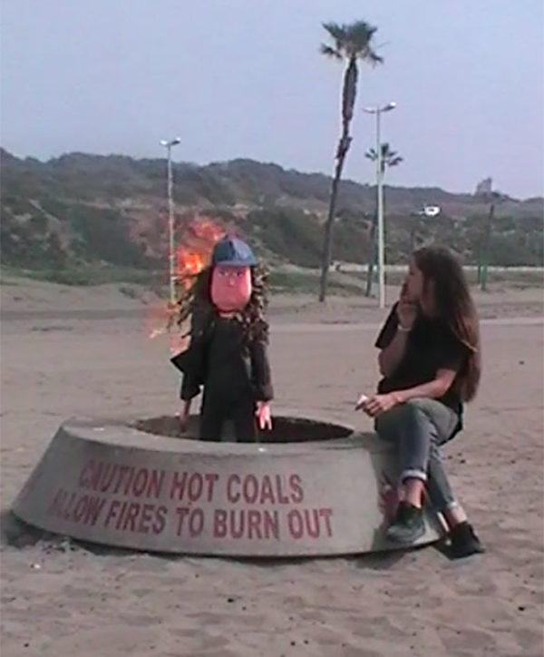 Leap Day video sand beach burning pinata los angeles cigarette
